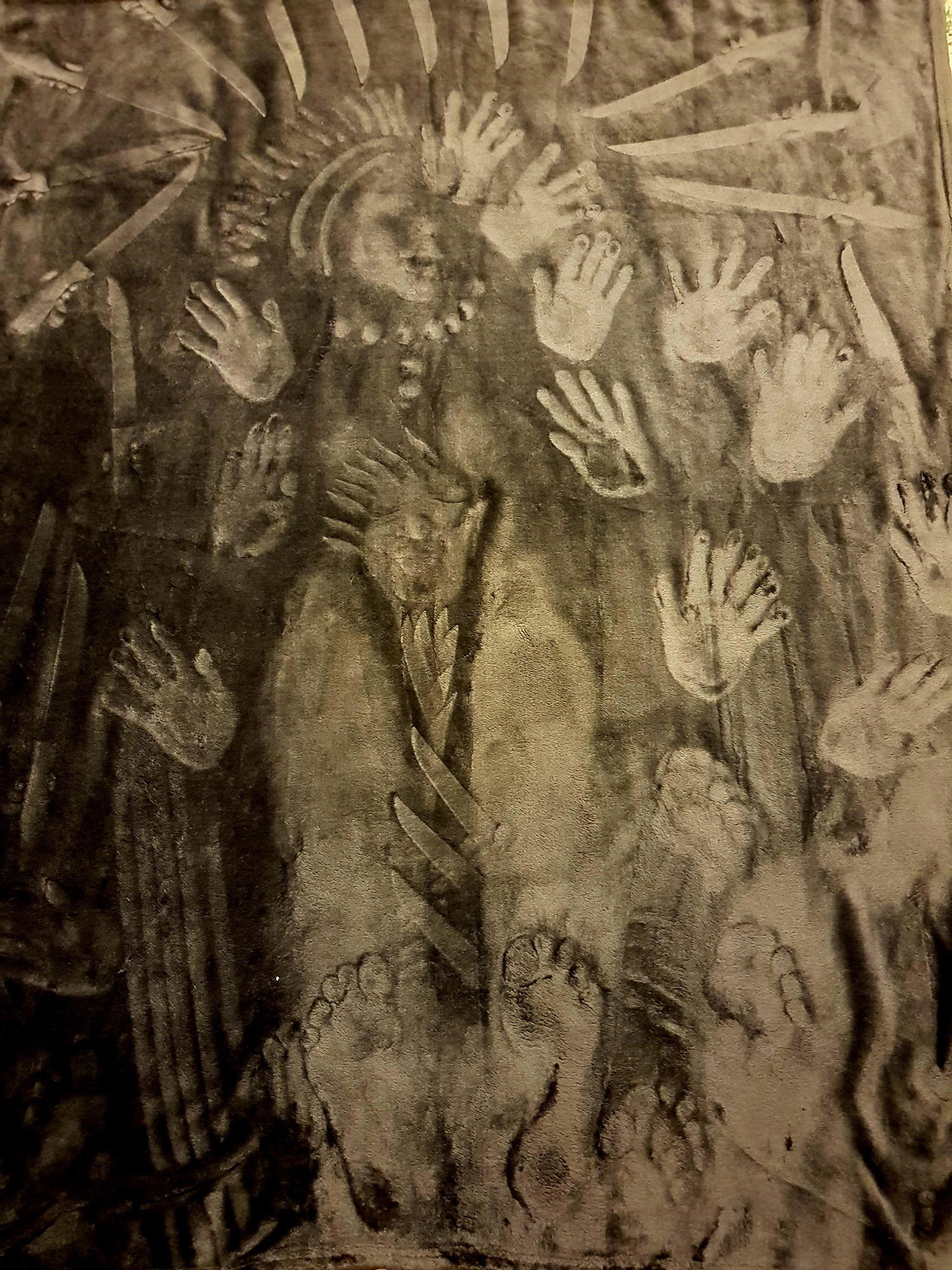 nightmare type image of faces, hands and feet as though pressed against the screen surrounded by knives