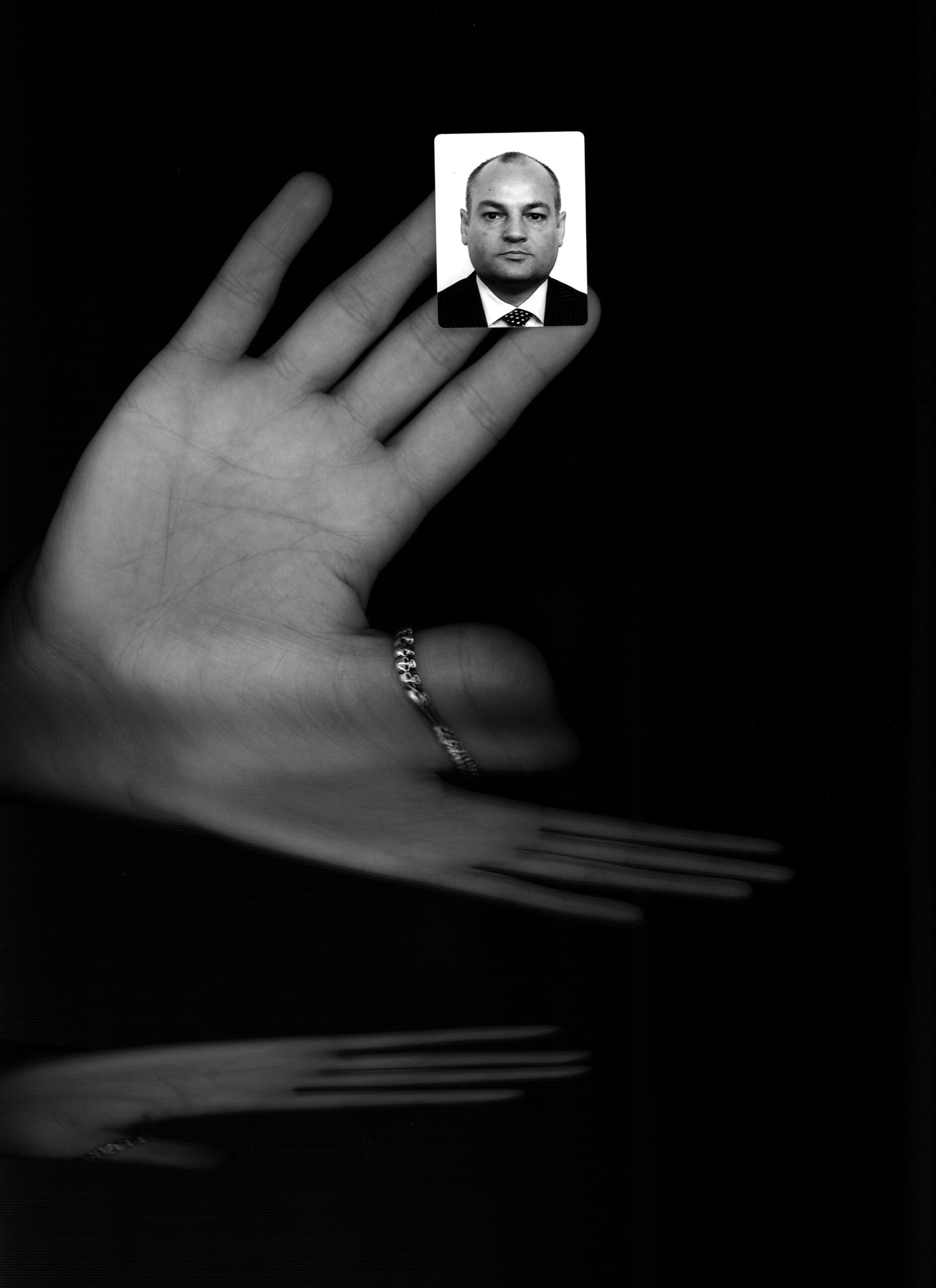 Passport Photo on hand Black and White