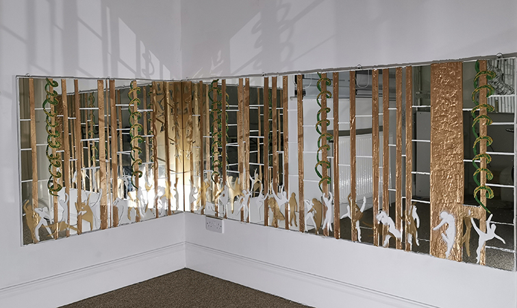 abstract artwork of mirrors and gold paint