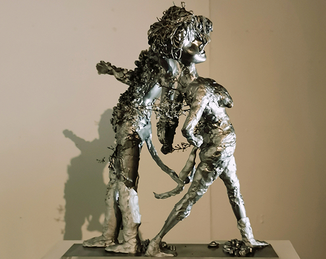abstract sculpture of silver human forms