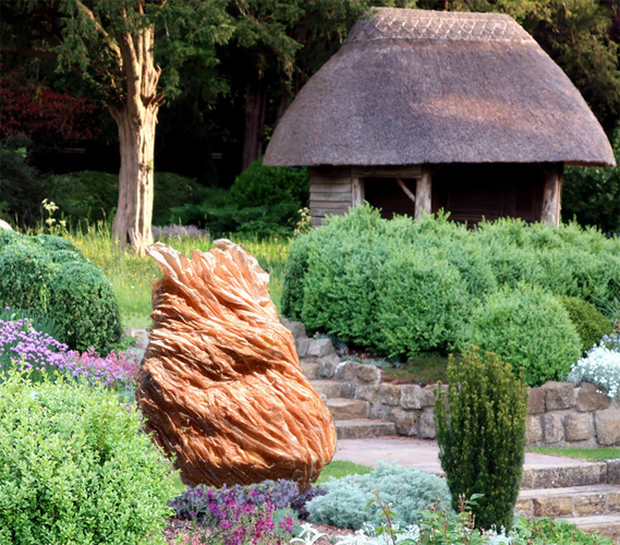 Resin sculpture in garden setting