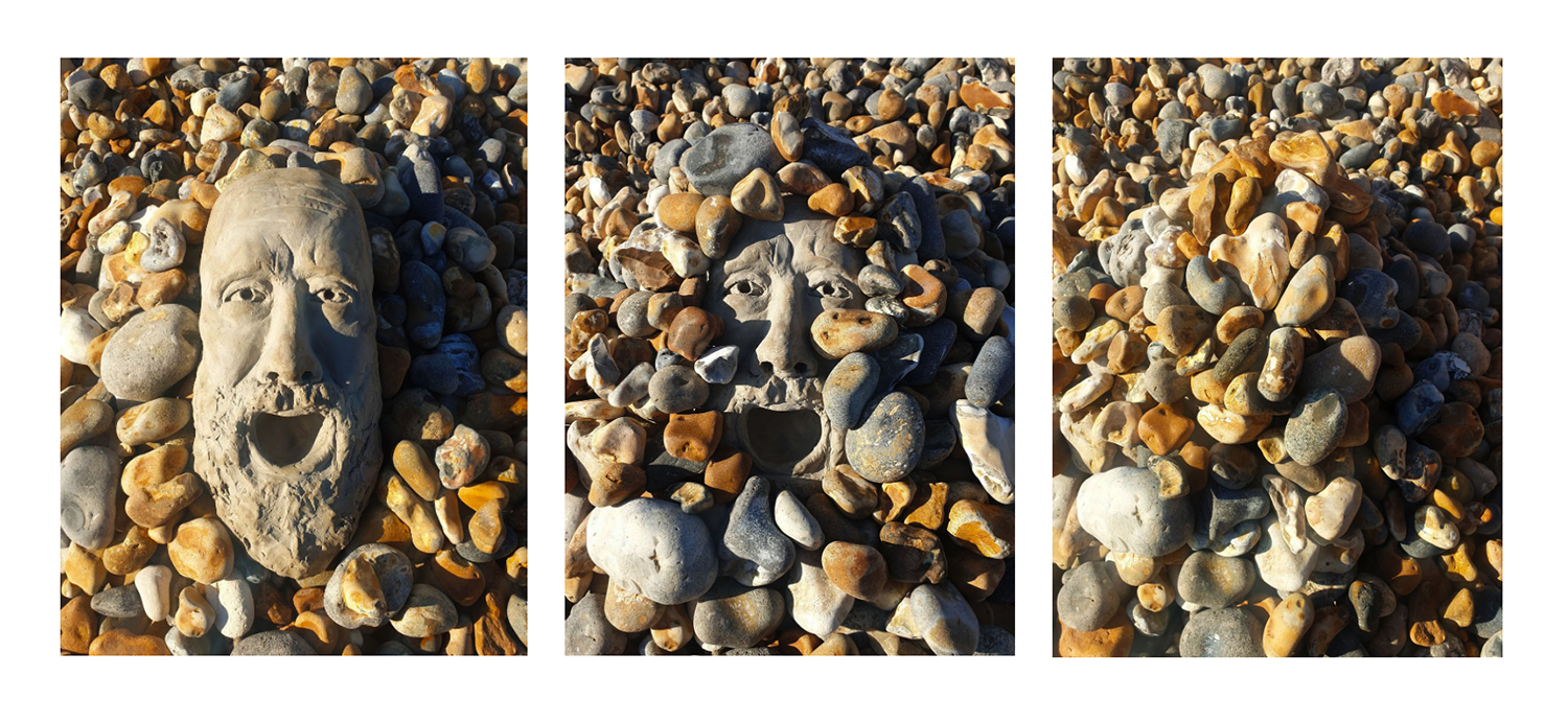 Pebbles on the beach with masks in it