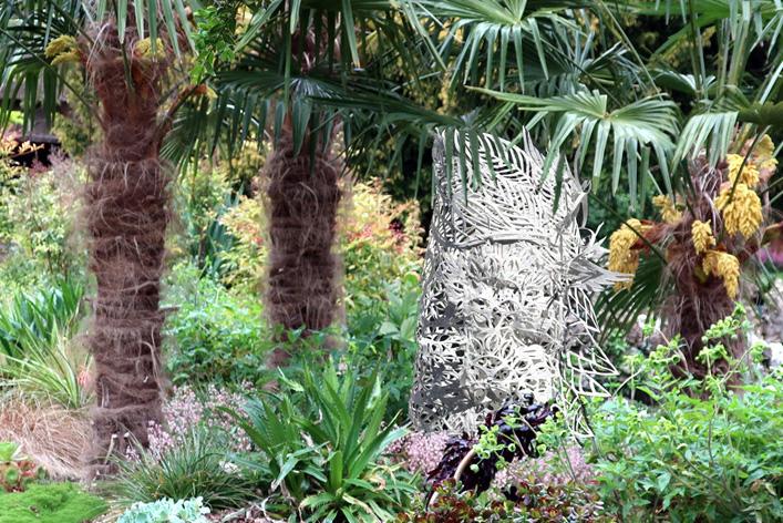 sculpture in plant scene