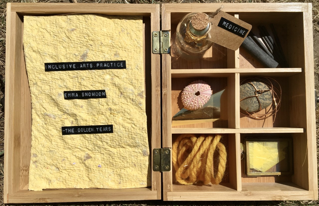 Collection of objects in wooden box